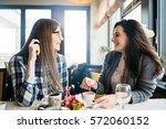 two happy friends coffee talk...   Shutterstock . vector #572060152
