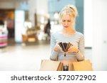 no money left. mature... | Shutterstock . vector #572072902