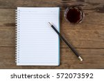 notebook coffee and pencil on... | Shutterstock . vector #572073592