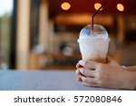 hand of woman holding coffee...   Shutterstock . vector #572080846