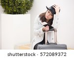 tired young hipster traveler... | Shutterstock . vector #572089372