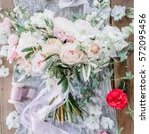 beauty wedding bouquet of roses | Shutterstock . vector #572095456
