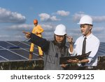 solar power plant. engineer and ... | Shutterstock . vector #572099125