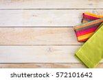linen dinner napkins on a wood... | Shutterstock . vector #572101642