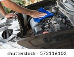 wipe cleaning the car engine... | Shutterstock . vector #572116102