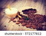 cup of coffee on wooden... | Shutterstock . vector #572177812