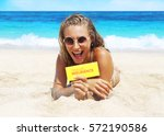 woman on the beach | Shutterstock . vector #572190586