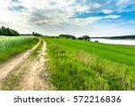 Rural Road And Green Field In...