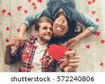 top view of happy young couple... | Shutterstock . vector #572240806