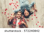 top view of happy young couple... | Shutterstock . vector #572240842
