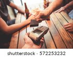 friends are drinking beer while ... | Shutterstock . vector #572253232