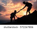 giving a helping hand. man... | Shutterstock . vector #572267806