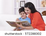 mother and son reading a... | Shutterstock . vector #572288302