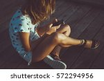 Young Cute Woman Using Phone...
