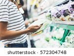 young woman shopping healthy...   Shutterstock . vector #572304748
