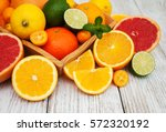 Fresh Citrus Fruits On A Old...