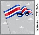 costa rican flag wavy abstract... | Shutterstock .eps vector #572327086
