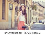 young woman walking with her... | Shutterstock . vector #572345512