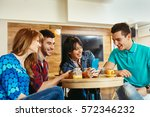group of young people having... | Shutterstock . vector #572346232