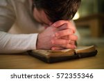 unrecognizable man praying ... | Shutterstock . vector #572355346
