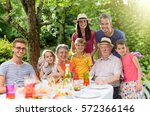 in summer  family reunion... | Shutterstock . vector #572366146