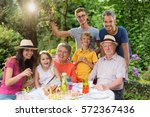 in summer  family reunion... | Shutterstock . vector #572367436