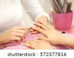 enjoying manicure in salon. | Shutterstock . vector #572377816