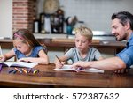 father helping kids with their... | Shutterstock . vector #572387632