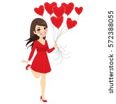 beautiful brunette girl holding ... | Shutterstock .eps vector #572388055