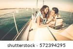 young couple in love on sail...   Shutterstock . vector #572394295