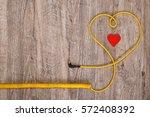 heart of yellow headphones... | Shutterstock . vector #572408392