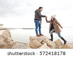 beautiful couple being playful... | Shutterstock . vector #572418178