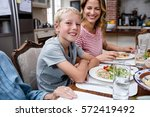 portrait of boy having meal... | Shutterstock . vector #572419492