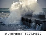 Waves Breaking On A Breakwater