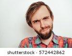 man looking with contempt | Shutterstock . vector #572442862