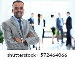 portrait of smiling african... | Shutterstock . vector #572464066