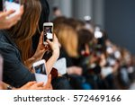 woman holding phone during the... | Shutterstock . vector #572469166
