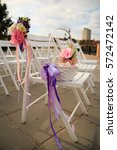 Small photo of Wedding bouquet of roses decorated with purple ribbons for the wedding cer