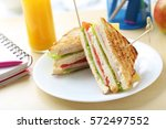 tasty and fresh sandwiches on a ... | Shutterstock . vector #572497552