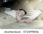 an asian kid sleep with smile... | Shutterstock . vector #572499856