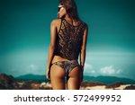 outdoor fashion female model...   Shutterstock . vector #572499952
