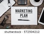 marketing plan written on note... | Shutterstock . vector #572504212