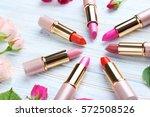 colorful lipsticks on white... | Shutterstock . vector #572508526