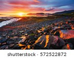 the picturesque sunset over... | Shutterstock . vector #572522872
