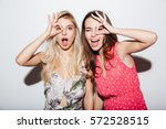 portrait of two laughing female ... | Shutterstock . vector #572528515