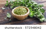 fresh and dried oregano herb on ... | Shutterstock . vector #572548042
