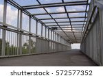 latticework footbridge over the ... | Shutterstock . vector #572577352
