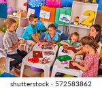 child dough play in school.... | Shutterstock . vector #572583862