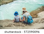 mom and young son sitting on... | Shutterstock . vector #572590096