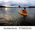 Man On Kayak With Sunset ...